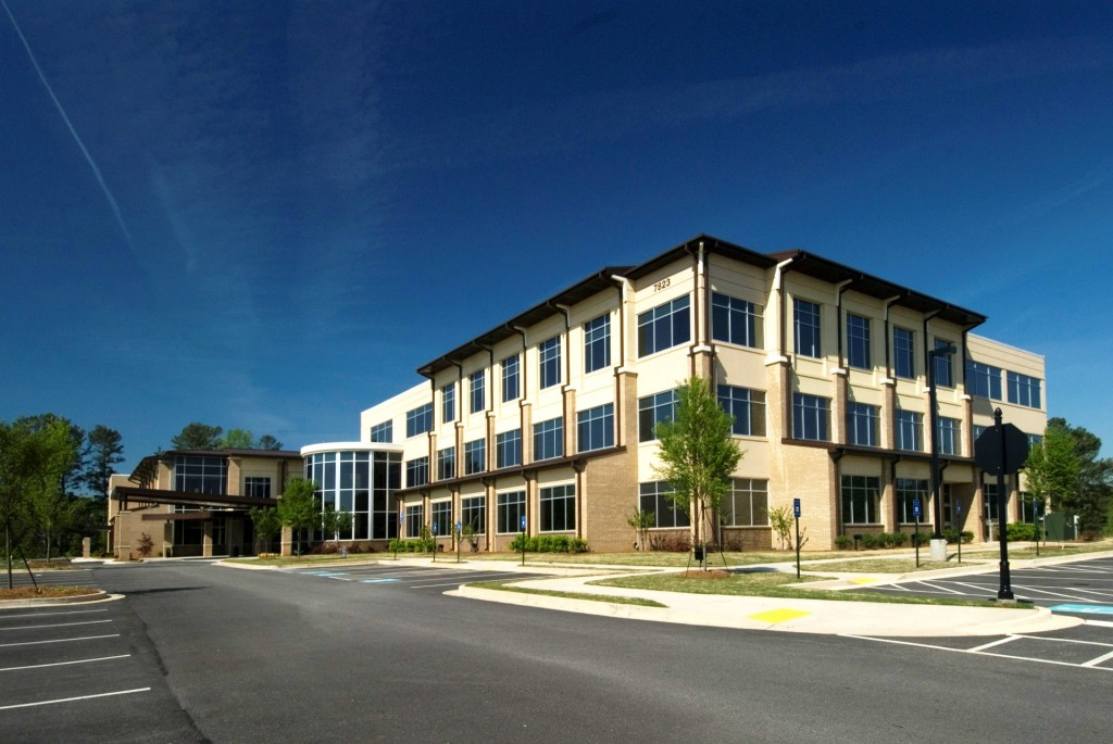 CNL paid a reported $18.6 million for the three-story, 47,159 square foot Spivey Station Surgery Center in Jonesboro, Ga. Meadows & Ohly had acquired the facility from Southern Crescent Real Estate in 2008 for a reported $7.8 million. (Photo courtesy of CDH Partners Inc.)