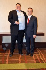 Erik Tellefson (left, shown with HREI Publisher Murray W. Wolf) collected his HREI Insights Awards™ award at the RealShare conference in Scottsdale, Ariz., in December. (HREI photo)