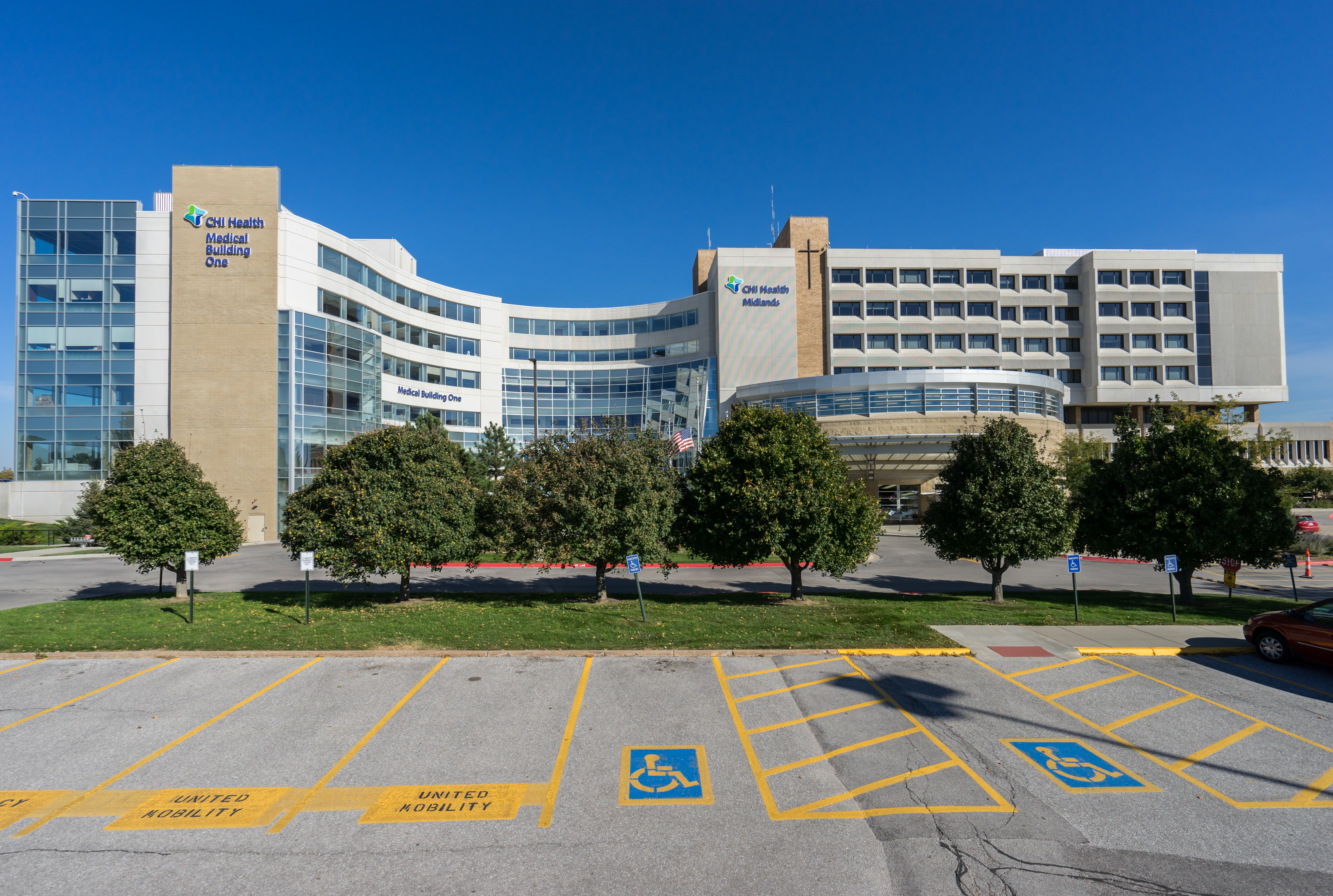 As part of its $692 million portfolio acquisition from Catholic Health Initiatives (CHI), Physicians Realty Trust acquired CHI Medical Building One (left), which is connected to the 121-bed building CHI Health Midlands Hospital (right) in Papillion, Neb. Photo courtesy of CBRE Group Inc.