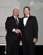 Ian Hughes of Lillibridge (right) received congratulations from Brian Harnetiaux, Chair and Chief Elected Officer - BOMA, for his Regional Member of the Year Award during the 2017 BOMA International TOBY Awards in late June in Nashville. (Photo courtesy of BOMA)
