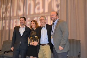 Anchor Health Properties Co-Founders Paul Crowley and Lou Sachs (center), flanked by two of their Anchor colleagues, CEO Ben Ochs (left) and Chief Investment Officer James A. Schmid III (right), pose for a celebratory photo after receiving the 2017 HREI Insights Awards™ Lifetime Achievement Award at the RealShare HRE conference in Scottsdale, Ariz., in December. (HREI™ photo)
