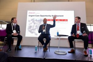 Gary Weatherford of GoHealth Urgent Care (center) describes his firm's approach to evaluating urgent care center opportunities during the ICSC RECon convention in Las Vegas. He was joined by moderator David Wirth of Cushman & Wakefield (left) and fellow panelist Alan Ayers of Urgent care Consultants (right). (Photo courtesy of ICSC)